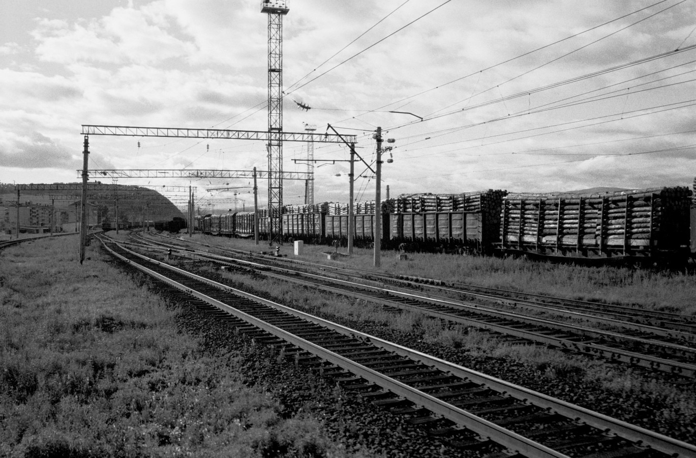 Endless trains with timber moving Westbound